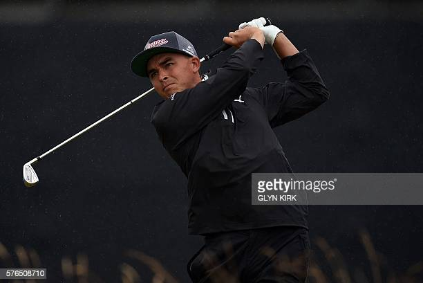 US golfer Rickie Fowler watches his drive from the 15th tee during his second round on day two of the 2016 British Open Golf Championship at Royal...