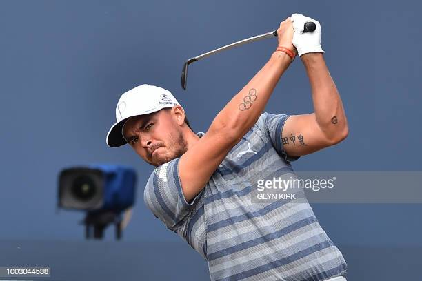 US golfer Rickie Fowler watches his iron shot from the 1st tee during his third round on day 3 of The 147th Open golf Championship at Carnoustie...