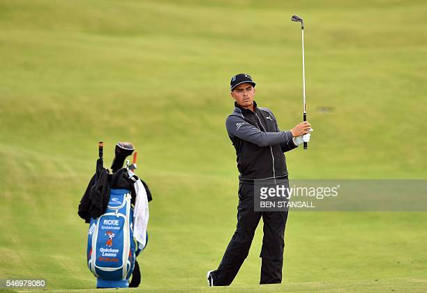 US golfer Rickie Fowler watches his shot from the 13th fairway during practice on July 13 ahead of the 2016 British Open Golf Championship at Royal...