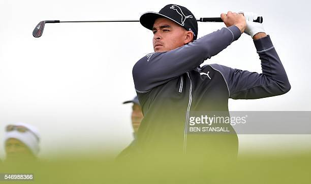 US golfer Rickie Fowler watches his shot from the 14th tee during practice on July 13 ahead of the 2016 British Open Golf Championship at Royal Troon...
