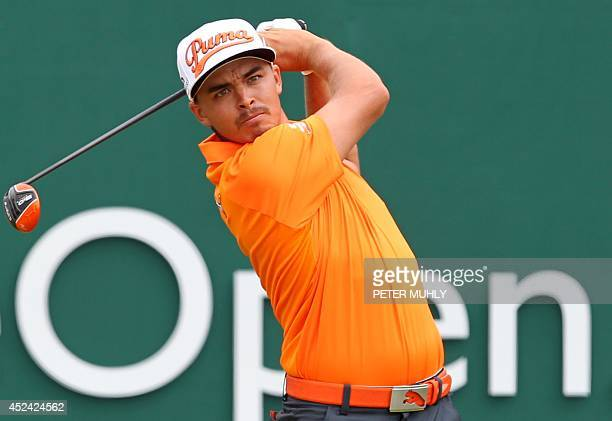 US golfer Rickie Fowler watches his shot from the 1st tee during his fourth round on the final day of the 2014 British Open Golf Championship at...