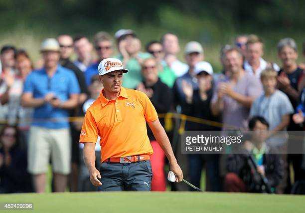 US golfer Rickie Fowler watches his shot from the 5th bunker during his fourth round on the final day of the 2014 British Open Golf Championship at...