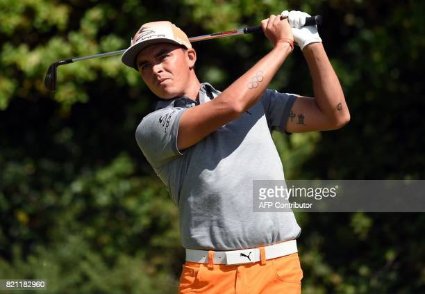 US golfer Rickie Fowler watches his shot from the 5th tee during his final round on day four of the 2017 Open Golf Championship at Royal Birkdale...