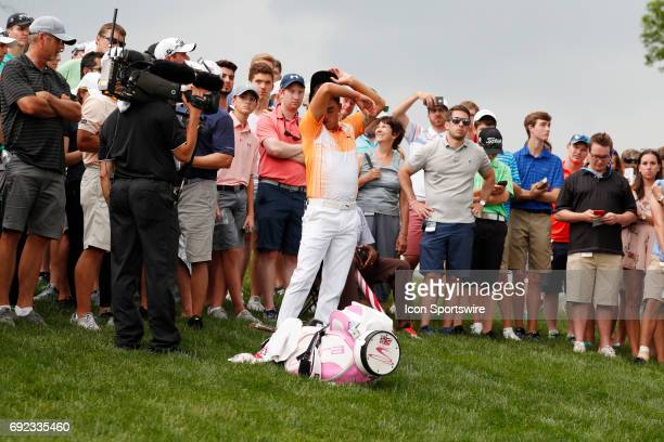 PGA golfer Rickie Fowler wipes the sweat from his face on the 13th hole as play is stopped for a weather delay during the Memorial Tournament Final...