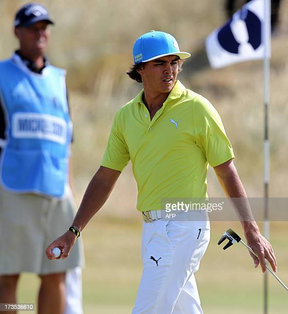 US golfer Ricky Fowler walks across the 10th green at Muirfield golf course at Gullane in Scotland on July 16 2013 ahead of The 2013 British Open...