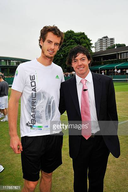 Golfer Rory McIlroy meets tennis player Andy Murray on Day Eight of the Wimbledon Lawn Tennis Championships at the All England Lawn Tennis and...