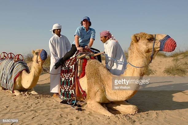 Golfer Rory McIlroy of Northern Ireland poses for photos during a visit to Bab Al Shams Hotel at Jumeirah Bab Al Shams Desert Resort Spa on January...