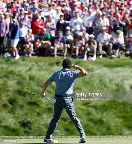 USA golfer Rory McIlroy taunts the gallery to make some noise after sinking a long birdie putt on the 8th hole during match play against USA player...