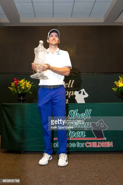 PGA golfer Russell Henley poses for pictures after winning the Shell Houston Open on April 02 2017 at Golf Club of Houston in Humble TX