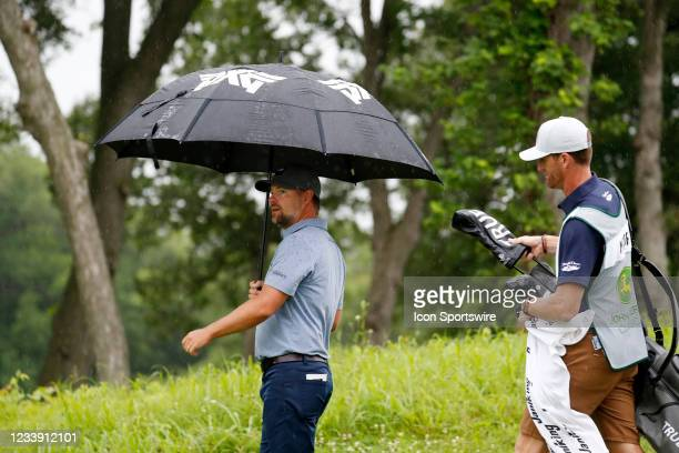 Golfer Ryan Moore and his caddie walk the 5th hole in the rain during the John Deere Classic on July 10, 2021 at TPC Deere Run in Silvis, Illinois.