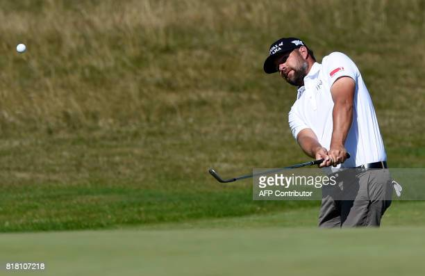 Golfer Ryan Moore chips onto the 6th green during a practice round at Royal Birkdale golf course near Southport in north west England on July 18...