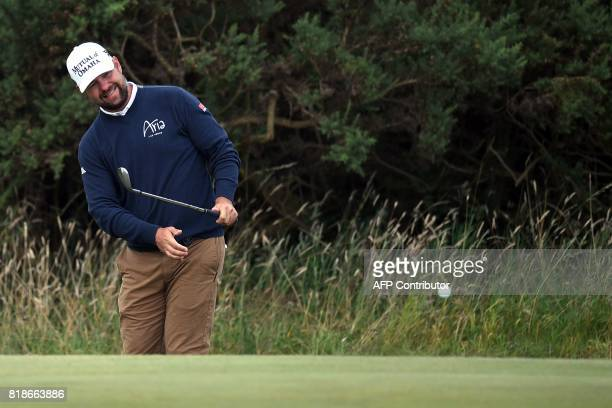 Golfer Ryan Moore chips onto the 9th green during a practice round at Royal Birkdale golf course near Southport in north west England on July 19...