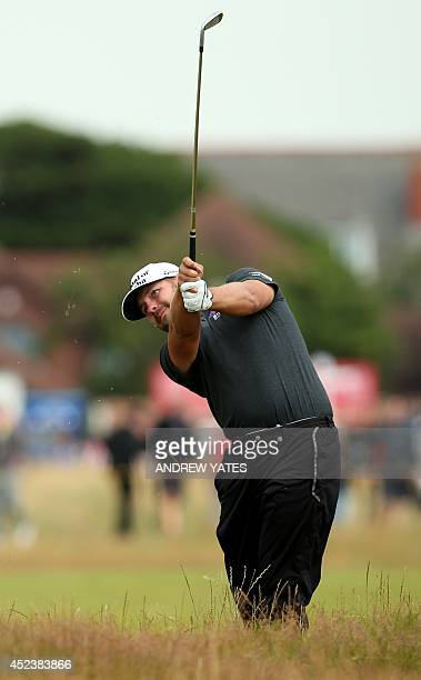 Golfer Ryan Moore plays out of the rough on the 17th hole during his third round 73, on day three of the 2014 British Open Golf Championship at Royal...