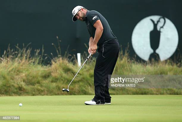 Golfer Ryan Moore putts on the 3rd green during his third round, on day three of the 2014 British Open Golf Championship at Royal Liverpool Golf...