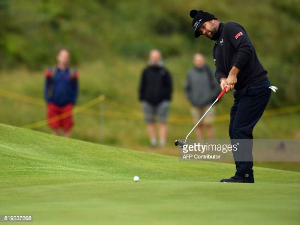 Golfer Ryan Moore putts on the 8th green during his opening round on the first day of the Open Golf Championship at Royal Birkdale golf course near...