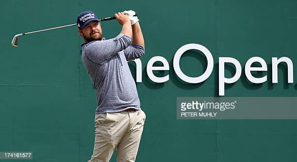 Golfer Ryan Moore tees off from the first during the fourth and final round of the 2013 British Open Golf Championship at Muirfield golf course at...