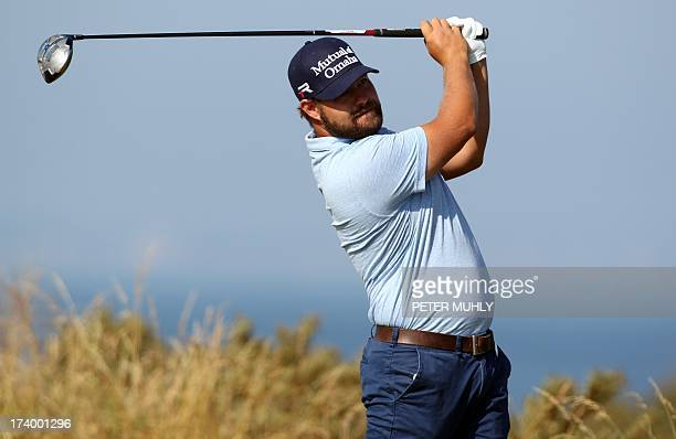 Golfer Ryan Moore tees off on the fifth during the second round of the 2013 British Open Golf Championship at Muirfield golf course at Gullane in...