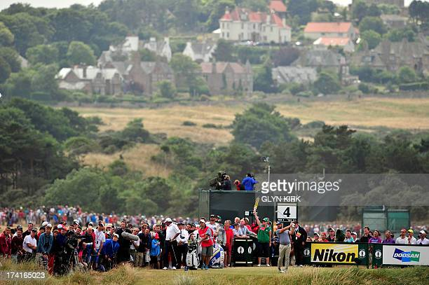 Golfer Ryan Moore tees off on the fourth during the fourth and final round of the 2013 British Open Golf Championship at Muirfield golf course at...