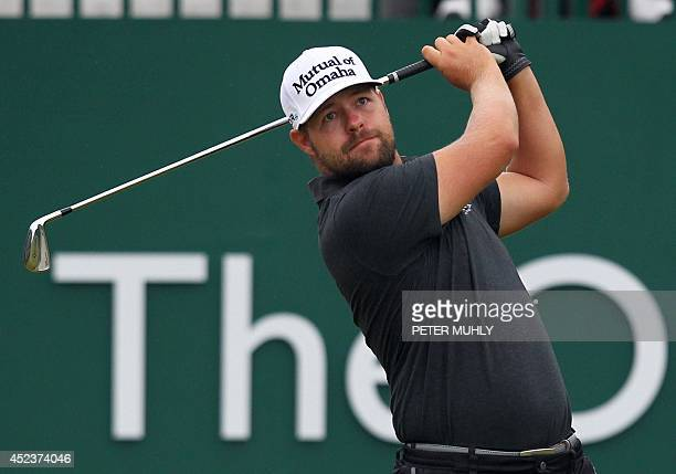 Golfer Ryan Moore watches his shot from 1st tee during his third round, on day three of the 2014 British Open Golf Championship at Royal Liverpool...