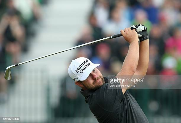 Golfer Ryan Moore watches his shot from the 4th tee during his third round, on day three of the 2014 British Open Golf Championship at Royal...