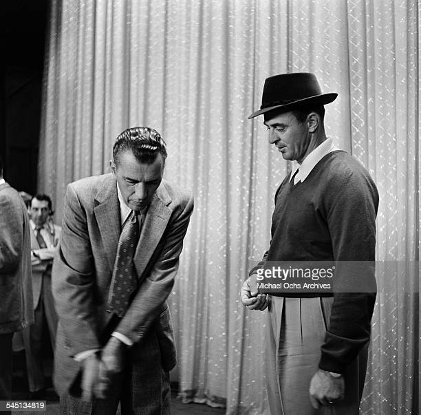 Golfer Sam Snead shows Ed Sullivan a golf swing during the 1954 Easter Show of the Toast of the Town show hosted by Ed Sullivan at the Maxine Elliott...