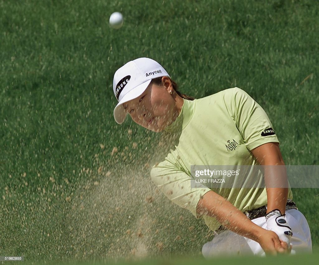 Golfer Se Ri Pak of South Korea hits out of a sand : News Photo