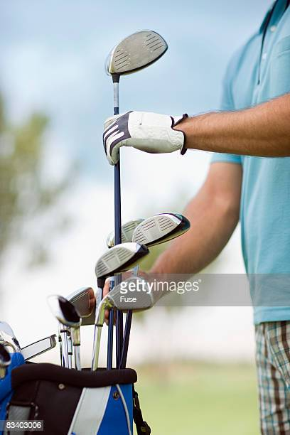 golfer selecting a golf club - driver golf club stock pictures, royalty-free photos & images