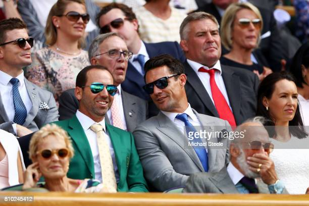Golfer Sergio Garcia and Dan Carter in discussion during the centre court royal box on day five of the Wimbledon Lawn Tennis Championships at the All...