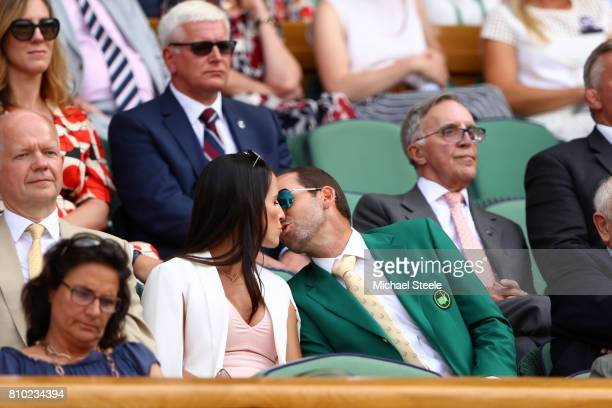 Golfer Sergio Garcia and fiancee Angela Akins share a kiss in the centre court royal box on day five of the Wimbledon Lawn Tennis Championships at...