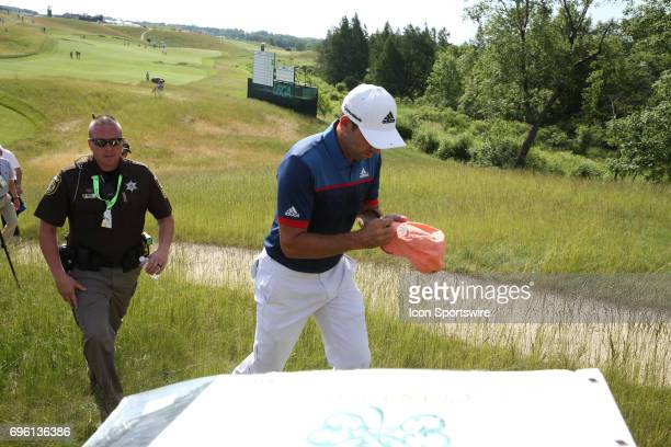 PGA golfer Sergio Garcia signs autographs as he walks to the 4th tee during the practice round for the 117th US Open on June 14 2017 at Erin Hills in...