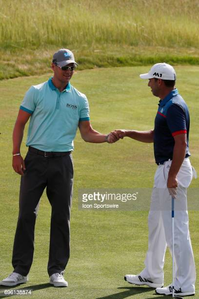 PGA golfer Sergio Garcia talks with Martin Kaymer on the 3rd hole during the practice round for the 117th US Open on June 14 2017 at Erin Hills in...