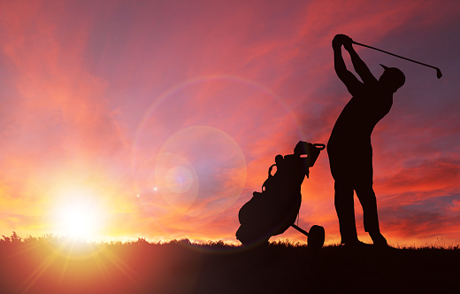 Golfer Silhouette During Sunset With Copy Space 961002976