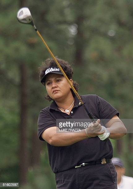 Golfer Smriti Mehra of India watches her tee shot on the 2nd hole 31 May 2001 during the first round of the US Women's Open at the Pine Needles Lodge...