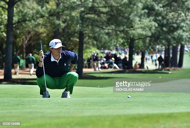 Golfer Smylie Kaufman lines up his putt on the 1st green during Round 3 of the 80th Masters Golf Tournament at the Augusta National Golf Club on...