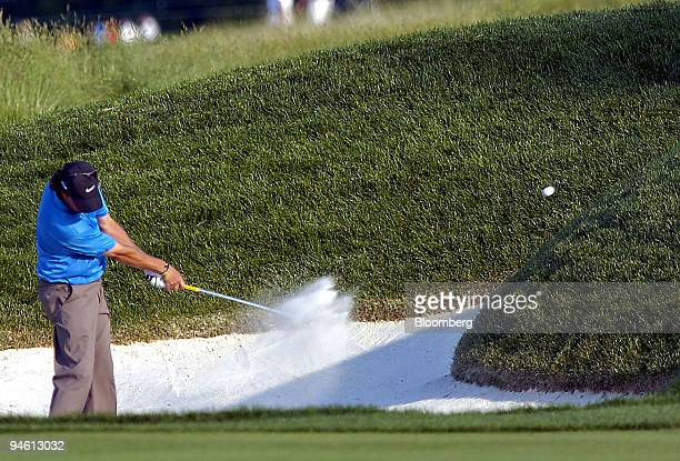 Golfer Stephen Ames hits ouf of a bunker onto the 18th fairway at Oakmont County Club in Oakmont Pennsylvania during the third round of the 107th US...