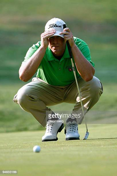 Golfer Steve Stricker lines up a putt on the 15th hole during the third round of the Barclays Classic golf tournament at Westchester Country Club in...