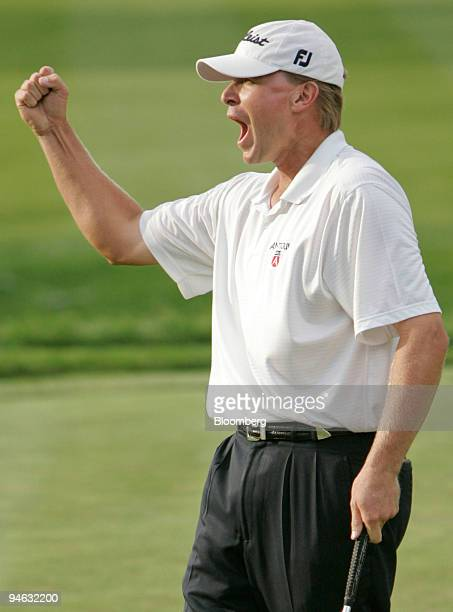 Golfer Steve Stricker reacts after sinking a birdie putt on the 18th hole of Barclays Classic golf tournament at Westchester Country Club in Rye New...