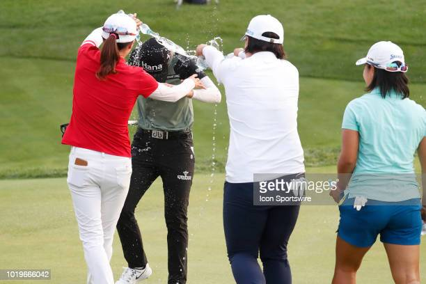 LPGA golfer Sung Hyun Park has water poured on her by fellow players Jennifer Song in red and Amy Yang in white after she won on the 18th hole in a...