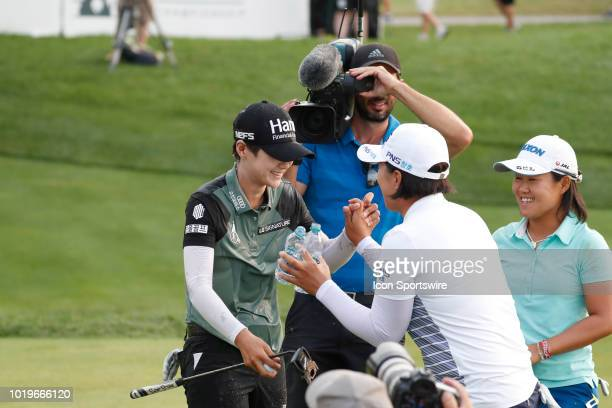 LPGA golfer Sung Hyun Park is congratulated by Amy Yang after winning on the 18th hole in a sudden death playoff during the final round of the Indy...