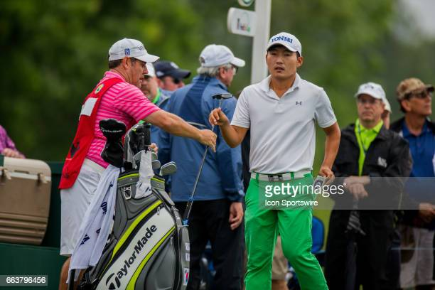 PGA golfer Sung Kang is handed his club at the third tee during the Shell Houston Open on April 02 2017 at Golf Club of Houston in Humble TX