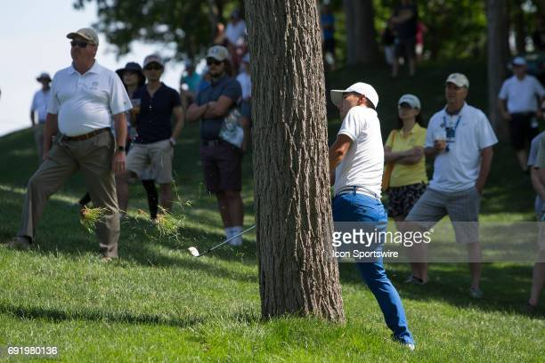 PGA golfer Sung Kang taking a swing from behind a tree during the Memorial Tournament Third Round on June 3 2017 at Muirfield Village Golf Club in...