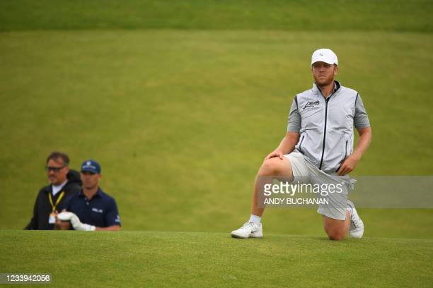 Golfer Talor Gooch stretches while waiting on the 7th fairway during a practice round for The 149th British Open Golf Championship at Royal St...