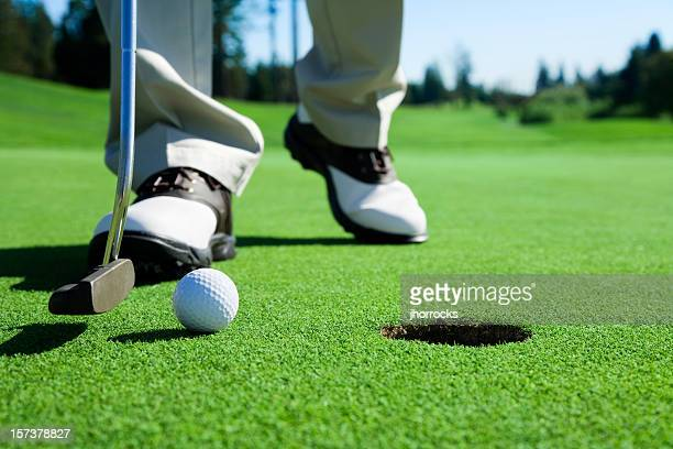 golfer tapping in - putting stock pictures, royalty-free photos & images