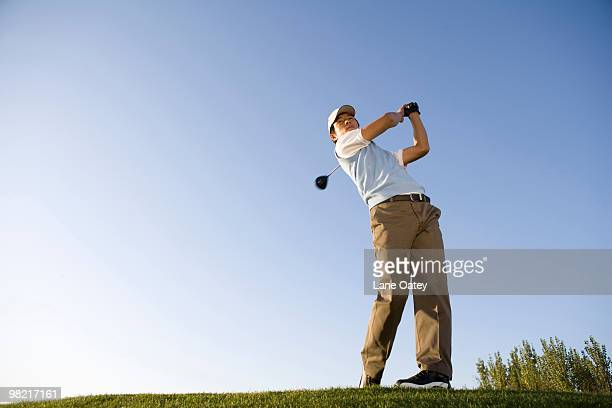 golfer teeing off on the course - teeing off stock pictures, royalty-free photos & images