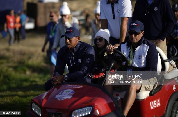 US golfer Tiger Woods and his girlfiend Erica Herman ride in a golf buggy the foursomes matches on the second day of the 42nd Ryder Cup at Le Golf...