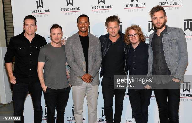Golfer Tiger Woods and members of the band OneRepublic guitarist Zach Filkins drummer Eddie Fisher singer Ryan Tedder guitarist Drew Brown and...