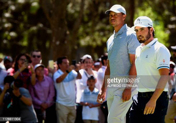 Golfer Tiger Woods and Mexican golfer Abraham Ancer walk to tee 3 during the first round of the World Golf Championship in Mexico City, at...