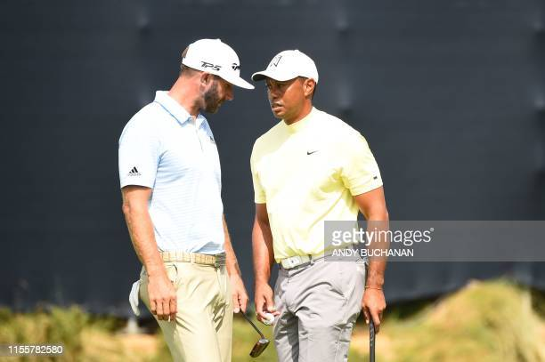 US golfer Tiger Woods and US golfer Dustin Johnson practice by the 15th hole at The 148th Open golf Championship at Royal Portrush golf club in...