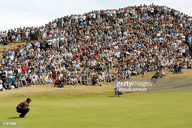 Golfer Tiger Woods and Vijay Singh of Fiji line up their putts on the 6th green during the final round at The Open Championship at Royal St. George's...