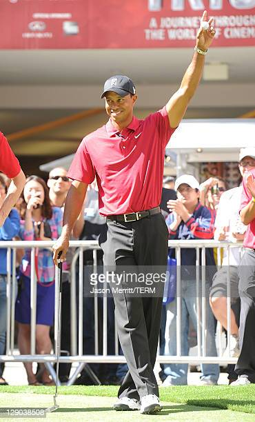 Golfer Tiger Woods announces the 2011 Chevron World Challenge field and putt with local fans on October 11, 2011 in Los Angeles, California.